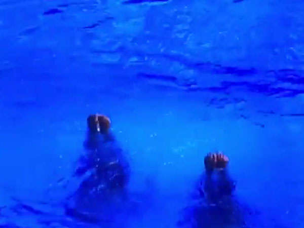 Watch An Olympic Swimming Duo Perform Their Routine A Hit A