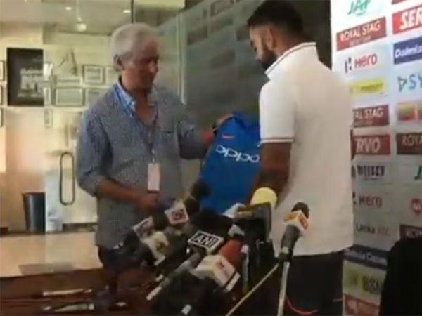 Video Virat Kohli Presents Sports Journalist R Kaushik With Team India Jersey