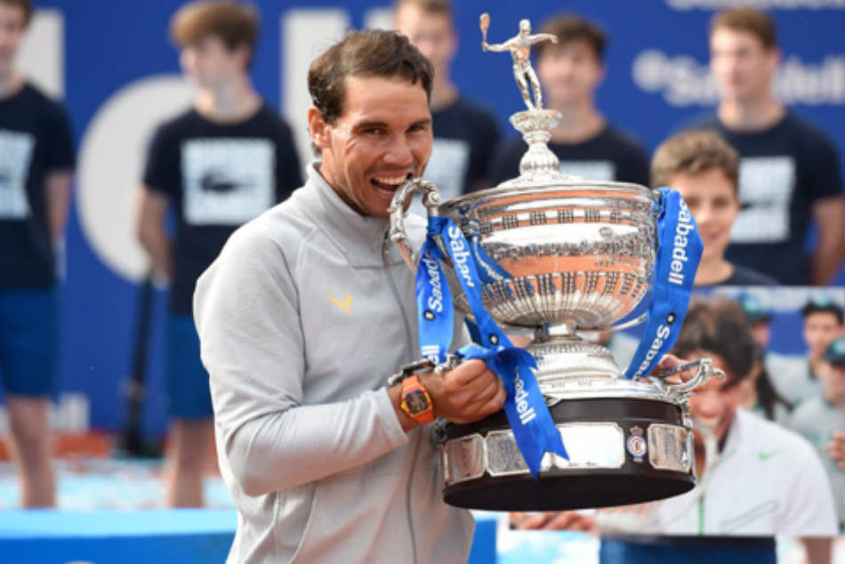 Domineering Nadal eases to 11th Barcelona title