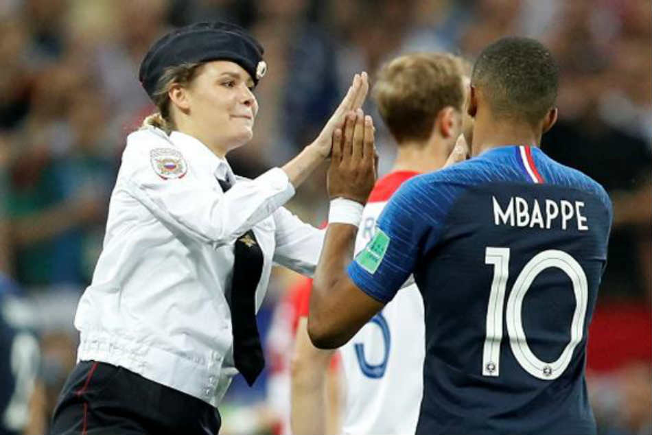 Pussy Riot protesters interrupt World Cup final, high-five Kylian Mbappe