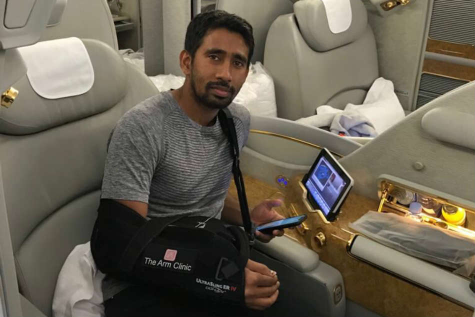 Wriddhiman Saha returns to India after undergoing shoulder surgery, to begin rehab after three weeks
