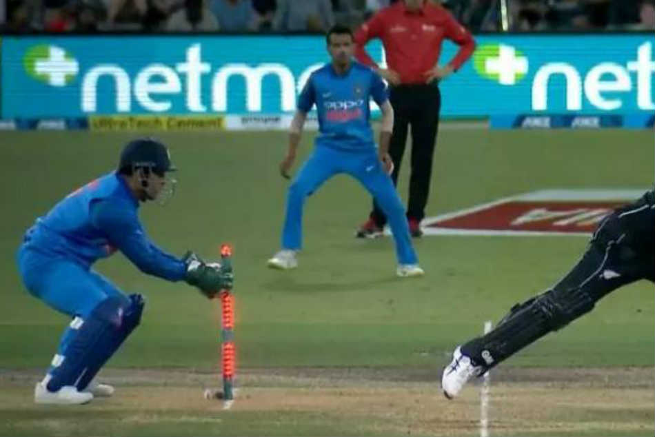 MS Dhoni, quick as a flash, stumps Ross Taylor. Awestruck fans cant keep calm