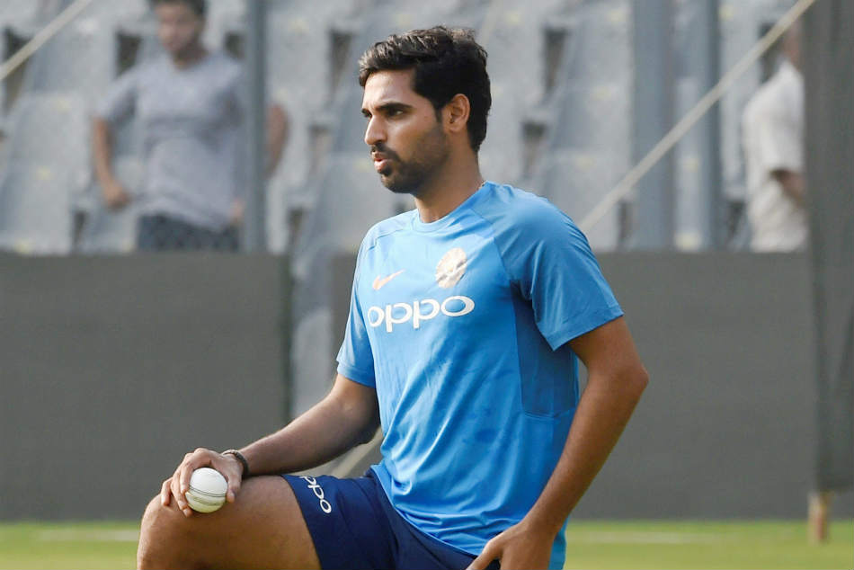 Indian fast bowler Bhuvneshwar Kumar practices during an indoor practice session in Manchester
