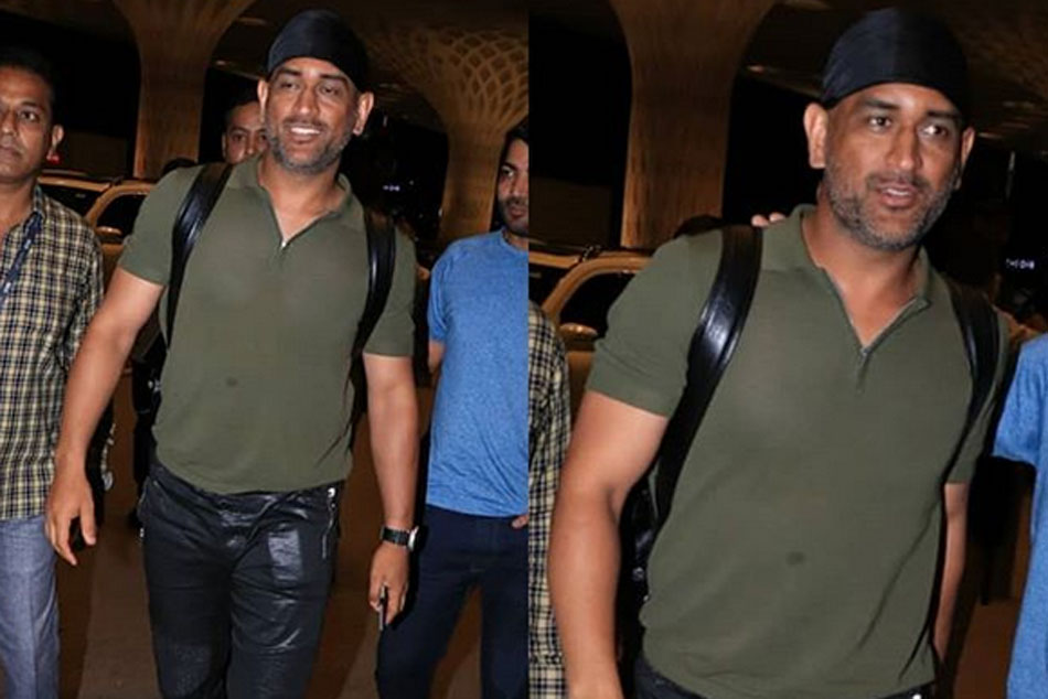 Viral Video Ms Dhoni Spotted At Jaipur Airport In A Brand New Look