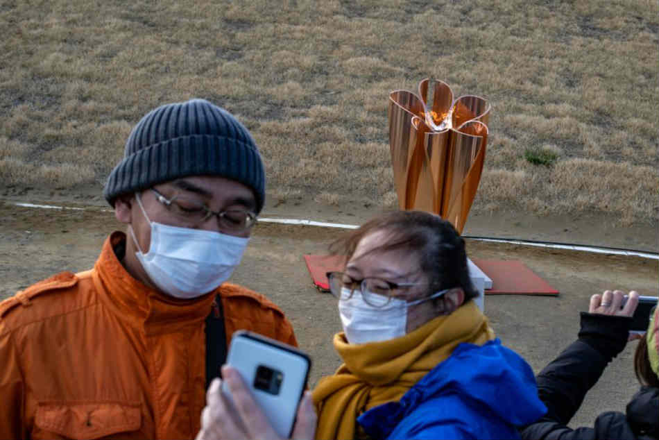 Olympic Flame Arrives In Japan As Coronavirus Throws Tokyo Games Into Growing Doubt