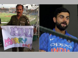 Kohli Marry Me Pakistani Policeman S Placard Virat Kohli Is Breaking The Internet