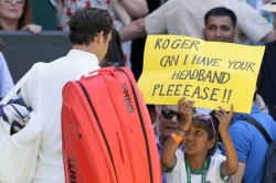 Young Tennis Fan Charms Federer With Headband Request