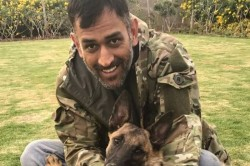 Ms Dhoni Cuddles His Pet Dogs As Ziva Watches On At Ranchi Residence
